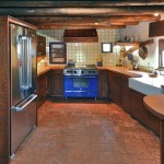 Rustic Spanish Cedar kitchen with carved details