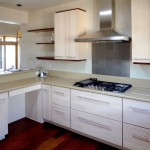 Big box kitchen cabinets augmented with custom details