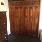 closet with hand carved panel