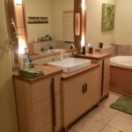 Fiddleback Ash vanity with maple countertops