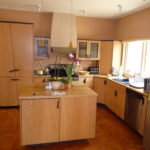 Eclectic modern kitchen with Fiddleback Anegre Veneer