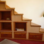 Asian style built in stair cabinetry